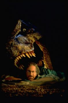 jurassic park Steven Spielberg in front with T-Rex head at back Michael Crichton, Martin Scorsese, Alfred Hitchcock, Stanley Kubrick, Cincinnati, Indiana Jones, Jurassic Park 3, Jurassic Movies, Steven Spielberg Movies