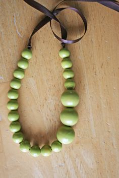 """V and Co.: tutorial: that lime green necklace."" To do with the wooden beads I found in Momma's things?? Different color for sure."