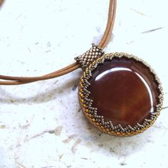 Tan leather necklace with woven bead embroidered carnelian pendant Bead Embroidery Jewelry, Beaded Embroidery, Beaded Jewelry, Beaded Necklace, Seed Bead Jewelry Tutorials, Jewelry Patterns, Leather Necklace, Bead Weaving, Tan Leather