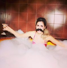 And this picture of her with a mustache and a martini in a bathtub. | 21 Reasons Marina And The Diamonds Should Always Be On Your Playlist