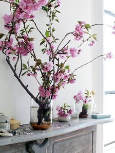 Cherry blossom wedding flowers. One big flowering branch in a vase makes a huge statement.: