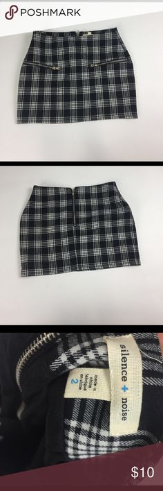 "Silence+Noise plaid mini skirt Silence + Noise by Urban Outfitters, black and white plaid pattern mini skirt with ""fake pockets."" There is a zipper on the back that opens and closes silence + noise Skirts Mini"