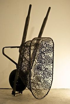 Artist, Cal Lane -sculpture, plasma-cutter. Functional objects such as shovels, wheelbarrows, oil cans, and I-beams, otherwise viewed in an industrial context, are subverted and elevated to the status of high art when transformed by plasma cutter and oxyacetylene torch into lacy sculptures