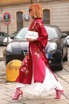 A flowing crimson kimono on top of Veronica Giomini's white Messagerie skirt during Milan Fashion Week.(Photo: Craig Arend for The New York Times)