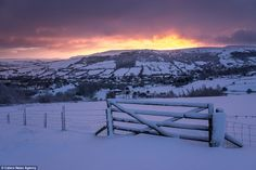 Stunning: This beautiful winter image captures the sun rising over snow-covered hills in P...