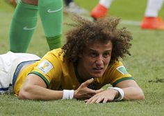 Brazil's David Luiz lies on the pitch after missing a goal during the 2014 World Cup third-place playoff between Brazil and the Netherlands at the Brasilia national stadium in Brasilia July 12, 2014