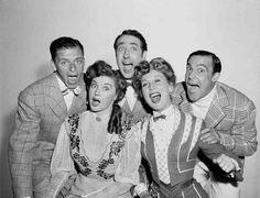 Medium publicity shot of Frank Sinatra as Dennis Ryan, Betty Garrett as Shirley Delwyn, Jules Munshin as Nat Goldberg, Esther Williams as K.C. Higgins, and Gene Kelly as Eddie O'Brien, singing.