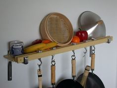 Great way to store pots and pans and other accessories. Taylor & Ng Track Rack 36'' Wall Pot Rack, Natural Bamboo
