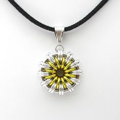 Daisy chainmaille pendant necklace by TattooedAndChained, starting at $20.00