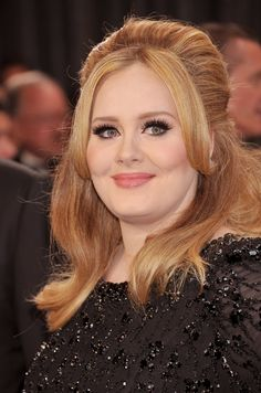 Adele's hair is half up with body