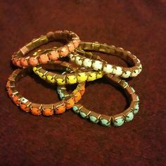 Wonderful set of color bracelet This set of 5 colorful bracelet was never worn. Stretches to fit any wrist. Gold accents. Jewelry Bracelets