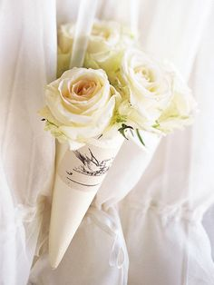 These Flower Cones are the perfect decoration and can double as a party favor! More paper projects here: http://www.bhg.com/wedding/favors/pretty-paper-projects-for-weddings/?socsrc=bhgpin112413flowercones&page=15
