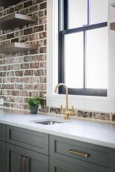 gorgeous kitchen finishes palette, exposed brick, white counter, and gold plumbing fixture from newport brass Exposed Brick Kitchen, Brick Wall Kitchen, White Kitchen Cabinets, Pantry Cabinets, Kitchen White, Exposed Brick Walls, Brick Wall Wallpaper Kitchen, Kitchens With Brick Backsplash, Kitchens With Brick Walls