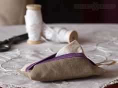 Elegant, vintage style, carefully handcrafted tissue case made from linen and cotton lace. Highlighted with purple finish.