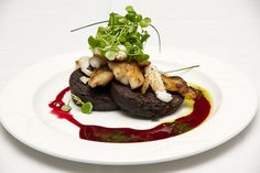 Pan fried cod cheeks resting on black pudding with a beetroot and chilli dressing