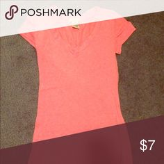 Bright pink v neck shirt This bright pink shirt has only been worn a couple times. It is 57% cotton, 38% polyester and 5% spandex. Deb Tops Tees - Short Sleeve