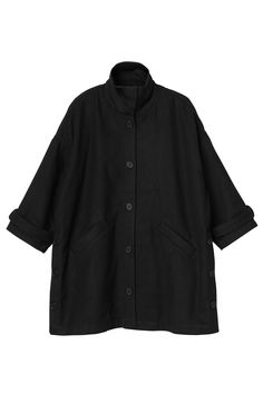 Coat check! Everything about this coat points to Yes, Click, Buy! It's black, softly felt-like, and just the right amount of oversized insulation we need hanging on our coat rack. Buttons down the front, up the sides and on the cuffs, slant side pockets and a soft'n'stretchy collar to fold up or down depending on how brrr you are.  colour: black magic  In a size small the chest width is 148 cm and the length is 89 cm. The model is 172 cm and is wearing a size small.