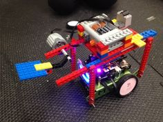 """mbot lego -  """"Soccor Bot"""" Unfortunately, the link to the instructions doesn't seem to work, but somehow you can use lego motors on mbots?!"""