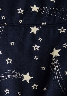This pocketed dress by hard-to-find British brand Emily and Fin will lift your spirits when you need it! Crafted from cotton and finessed with brilliant white shooting stars on its midnight-blue backdrop, this vintage-inspired frock makes you oh-so-merry.