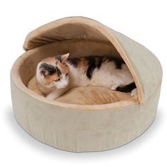 Maybe they would stay off my bed? The Warming Cat Bed (Large) - Hammacher Schlemmer