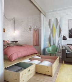This apartment bed sits on a platform with large, pull-out storage compartments. It works in a bedroom with such high ceilings!