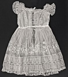 Sheer cotton batiste toddler's dress with ruched inserts and hand embroidery ... every delicate stitch by hand, ca. 1860-70. Photo courtesy the Metropolitian Museum of Art costume collection