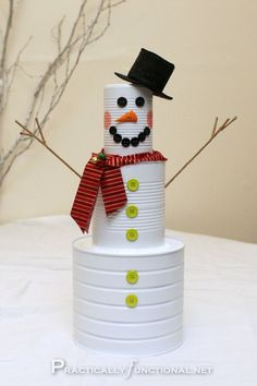 Tin Can Snowmen diy craft crafts easy crafts diy ideas diy crafts kids crafts winter crafts snowmen crafts for kids Snowman Christmas Decorations, Easy Christmas Crafts, Snowman Crafts, Christmas Snowman, Simple Christmas, Christmas Holidays, Christmas Ornaments, Christmas Stuff, Christmas Ideas