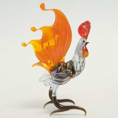 New Products. Red Tailed RoosterTaleFigure is a hand-created glass figurine which is h... http://russian-crafts.com/glass-figurines/glass-birds/red-tailed-rooster.html