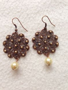 bronzy flower w/ gold beads n a pearl drop