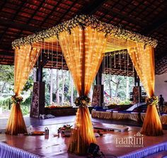 Mandap with fairy lights and drapes in orange
