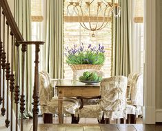 Dining Room With Pale Sage Green Curtains And Toile Slipcovers On The Chairs Interior
