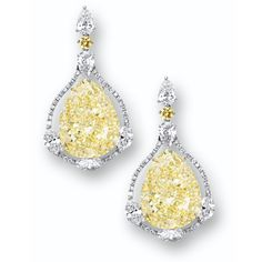 IMPRESSIVE PAIR OF FANCY YELLOW DIAMOND AND DIAMOND PENDENT EARRINGS. Each suspending on a pear-shaped fancy yellow diamond weighing 23.15 & 23.10 carats, to a brilliant-cut diamond-set frame of conforming shape, highlighted by 3 marquise-shaped diamonds, surmounted by 2 pear-shaped diamonds & a brilliant-cut yellow diamond, the marquise-shaped diamonds altogether weighing 3.26 carats, the pear-shaped diamonds altogether weighing 2.05 carats, mounted in 18 karat white & yellow gold.