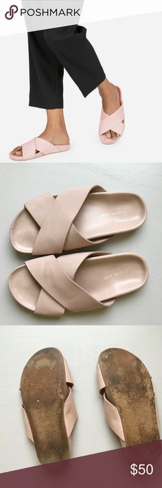 """Everlane The Form Crossover Sandals Blush Pink """"Comfortable doesn't have to mean unflattering—and we made a shoe to prove it. Made of supple Italian Nappa leather with a supportive contoured footbed, these sandals make every outfit 100% cooler—from breezy dresses to slouchy trousers.""""  Condition: Good, with several minor flaws in the leather around the toes and heels where it has been scuffs. No major stains or holes  Size 7 and TTS  Very comfy fit Everlane Shoes Sandals"""