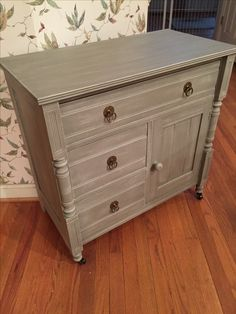 Antique cabinet painted with Annie Sloan French Linen then dry brushed with a mix of French Linen and Pure White (1:1) to create a weathered wood look.
