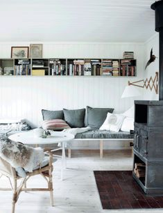 have some amazing ceiling shelves to store your favorite books in your small home. The designs that you will see in a short offer you sufficient New Furniture, Furniture Makeover, Ceiling Shelves, Scandinavian Home, Small Living, Home Projects, House Design, Living Room, Interior Design