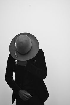 Fedora and rings.