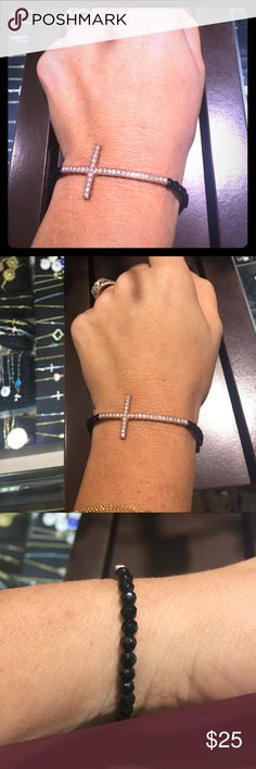 Woman's rose gold side cross bracelet Stylish rose gold plated side cross with CZ stones and black crystal band. Jewelry Bracelets