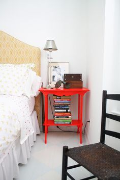 I love the red nightstand.