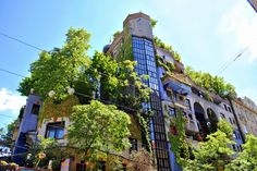 """Hundertwasser House, Vienna.  Friedensreich Hundertwasser , Inspired by the Vienna Secession movement, especially the work of Austrian painters Egon Schiele and Gustav Klimt, Hundertwasser incorporated his decorative, labyrinthine spirals into his paintings, architecture and designs for postage stamps and flags. He developed his own theory of """"transautomatism"""", which was inspired by the Surrealist concept of automatism (painting or drawing without conscious self-censorship), and sought to…"""