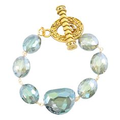 shabana Khan Women's Green Doreen Bracelet. Hand wired. Multiple faceted glass oval and nugget beads. Made in the usa.