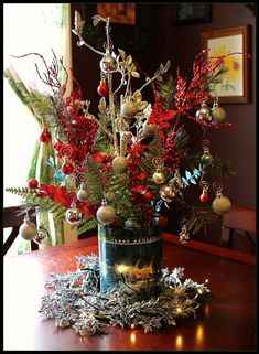 boy scout tin can table center piece, christmas decorations, seasonal holiday decor, Boy Scout Tin Can Table Center Piece for Christmas Christmas Wedding Centerpieces, Christmas Tablescapes, Diy Centerpieces, Christmas Decorations, Christmas Arrangements, Holiday Decorating, Floral Arrangements, Table Decorations, Christmas Popcorn Tins