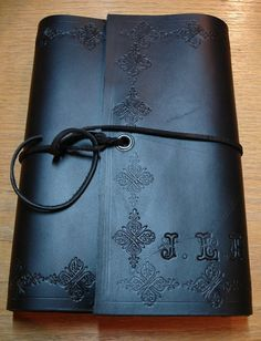 Custom Made Leather wrap around book cover by Green Man Leather Inc