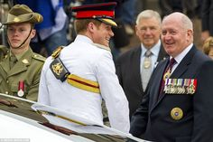 The 30-year-old was joined by Governor General Sir Peter Cosgrove (right) and he greeted dignitaries before entering the memorial