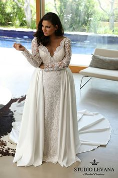 Royal plus size lace mermaid wedding gown with V neck, long sleeves and detachable second skirt. Milena. Studio Levana