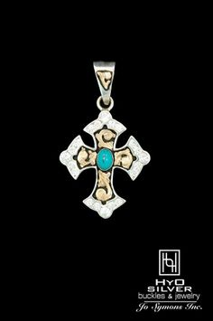 (RRP013 - $275) Sparkling crystals border the edge of this sterling silver cross pendant. Yellow gold overlay scrolls encase a vibrant gemstone of your choice in a bezel setting. Black antique background provides contrast for brilliant metallic hues of silver and gold. Gemstone options available. www.hyosilver.com