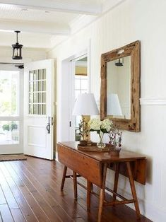Pretty rustic wooden mirror over slim lined table. Perfect for an entry way! by earlene