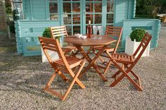 Create the perfect spot enjoy brunches or dinners outside with this 5-piece dining set, featuring an octagonal table and four folding chairs.
