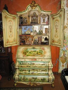 2(jt-take a closer look at this beautiful cabinet and it's miniature rooms by Aida Pravia pinned alongside. Also see her boards on Pinterest)