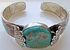 "Approx size of bangle from 3/ 8"" - 1 "". ( turquoise center piece). a watch instead the turquoise. shows some test marks at the inside of the bracelet. Unmarked for silver content ( tested positive for silver). 