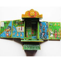 "This exclusive green 12in tall vintage ""Kawad"" is an amazing folded wooden Hindu temple whose origin is more than 500 years old is a great conversation piece and a collectors item.   Displaying hinged panels and doors where each door when opened shows colourful pictures and motifs illustrating the story of the great epic of Lord Krishna. shop this now at: www.theindianweave.com USD 90 